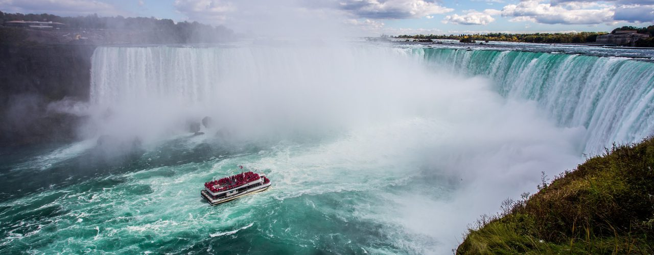 family vacation on boat at Niagara Falls