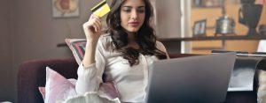 woman using prepaid debit while social distancing